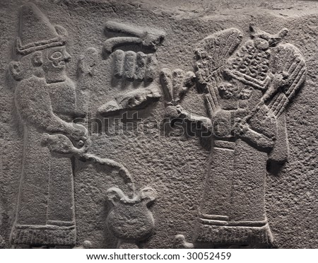 Bas-relief with the image of two ancient people with a jug - an exhibit from Museum of Anatolian Civilizations, Ankara, Turkey