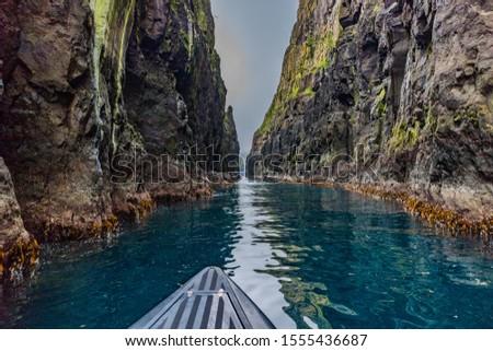 Basalt cliffs on Streymoy Island near Vestmanna, Faroe Islands, view from the boat  / Bazaltowe klify na wyspie Streymoy w pobliżu Vestmanna, Wyspy Owcze, widok z łodzi Zdjęcia stock ©