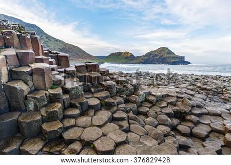 Basalt columns of Giants Causeway in Ireland #376829428
