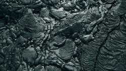 Basalt lava rock surface texture from a flow at Hawaii Volcanoes National Park, Big Island of Hawaii, USA. High quality photo