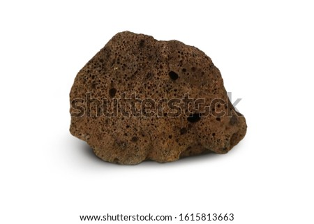 Basalt stone isolated on white background. Basalt is Extrusive igneous rock or Volcanic Rock. Basalt has a fine texture. Dark or gray to black, brown to heavy and mostly porous. Stock fotó ©