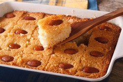 Basbousa pie with almonds macro in baking dish on the table. Horizontal