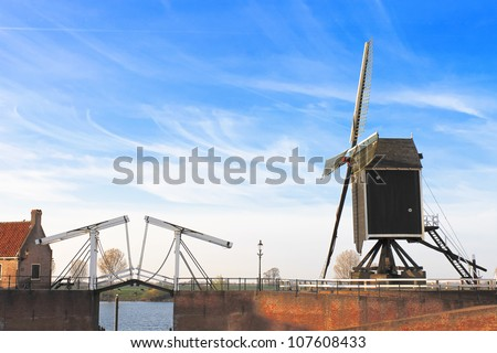 Bascule bridge and  windmill at sunset. Heusden. Netherlands