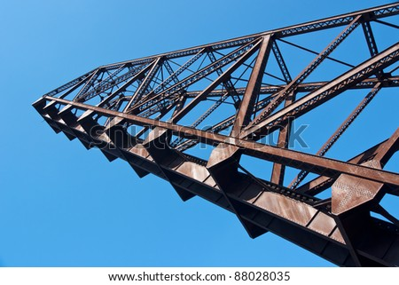 Bascule Bridge Arm:  The swing arm of an abandoned railroad bascule drawbridge is permanently in a fully raised position so ship traffic on the Cuyahoga River in Cleveland, Ohio can pass below it.