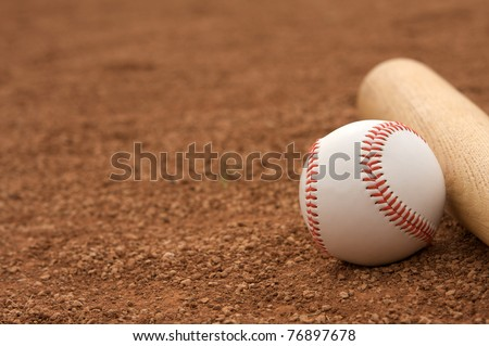 Baseball & Bat on the Infield Dirt with room for copy - stock photo