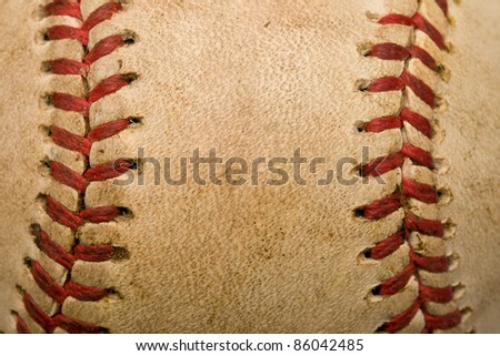Baseball background with closeup of worn ball
