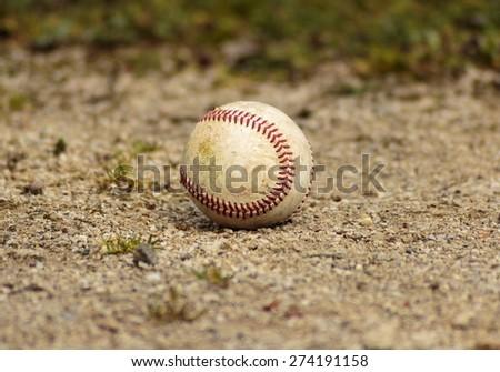 Baseball ball on gravel