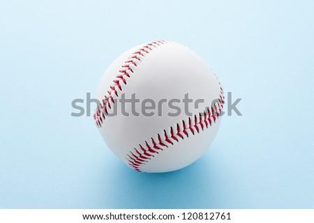 Baseball ball on light blue background