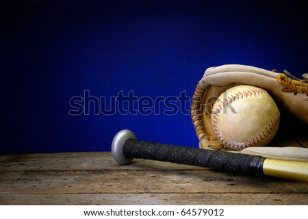 Baseball, bat, and mitt on old vintage wood table with copy space background old rusted screen and neon blue