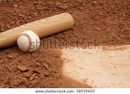 Baseball & Bat close up near home plate - stock photo