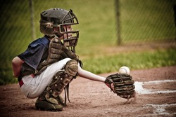Baseball Catcher with Ball in Action