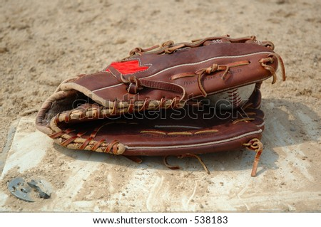 Baseball Glove on Home Plate - stock photo