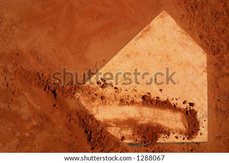 Baseball home plate. Red clay.