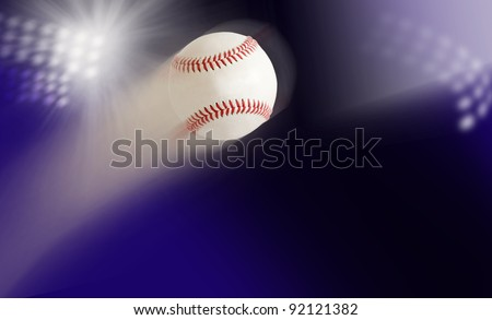baseball in air against the background of the stadium lights