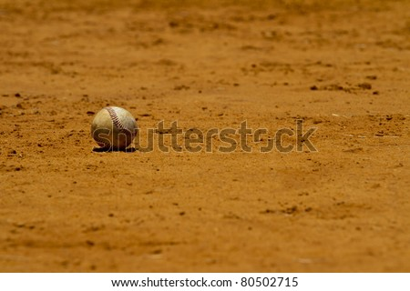 Baseball lies on a playing field
