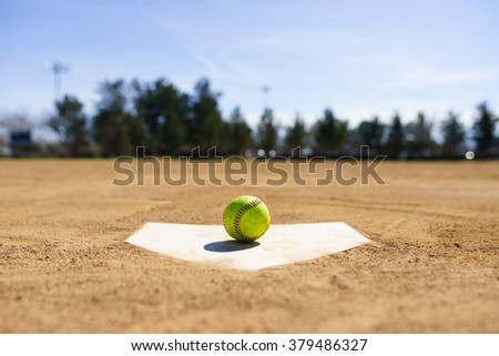 Baseball on a home plate in a baseball field in California mountains, Softball field