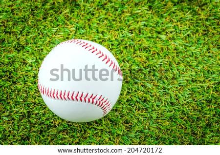Baseball on green grass
