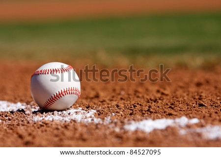 Baseball on the Chalk Line of the Infield