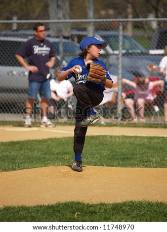 Baseball pitcher throwing the ball on the mound