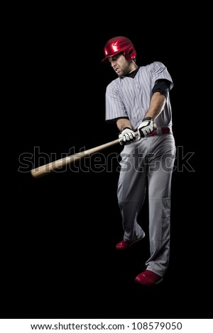 Baseball Player catching a ball on a black background.