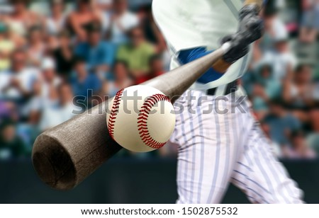 Baseball player hitting ball with bat in close up Stock photo ©