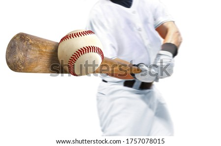 Baseball player hitting ball with bat over white background Stock photo ©