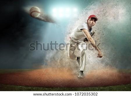 Baseball player in dynamic action around splash drops under stadium lights in evening match day.