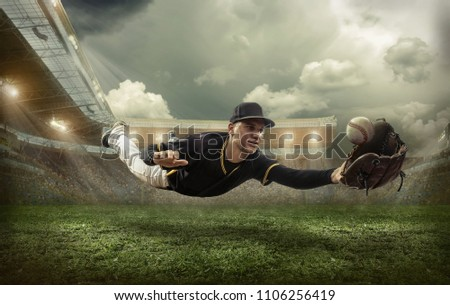 Baseball player in dynamic action under sky with clouds on the stadium. Stock photo ©