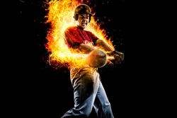 baseball player in fire hit a flying ball. isolated on black background