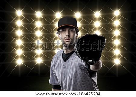 Baseball Player on a Orange Uniform on baseball Stadium.