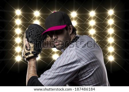 Baseball Player on a Pink Uniform on baseball Stadium.