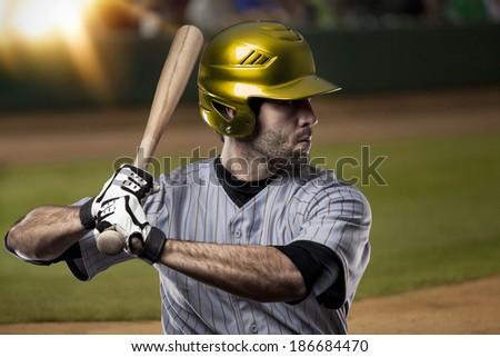 Baseball Player on a Yellow Uniform on baseball Stadium.
