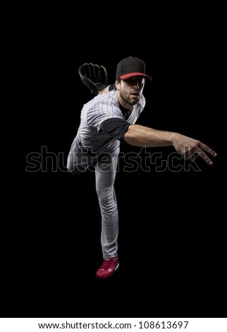 Baseball Player pitching a ball on a black background.