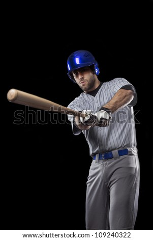 Baseball Player ready to swing, on a blue uniform.