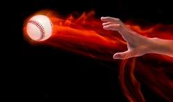 Baseball player throws the ball on fire power, A hand throwing a baseball fire