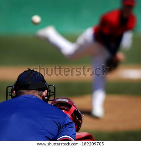 Baseball player wearing uniform throwing baseball