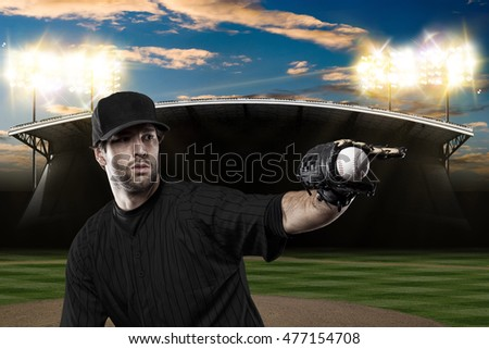 Baseball Player with a black uniform on baseball Stadium. #477154708