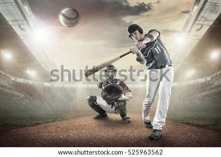 Baseball players in action on the stadium. #525963562