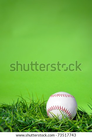 Baseball softball in the grass with green background and copy space