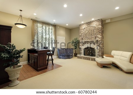 Basement In Luxury Home With Brick Fireplace Stock Photo