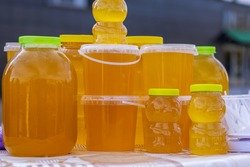 Bashkir bee honey poured into different containers for sale
