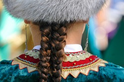 Bashkir girl with braids in a traditional dress
