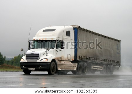 BASHKORTOSTAN, RUSSIA - SEPTEMBER 14, 2008: White Freightliner Columbia semi-trailer truck at the interurban road. #182563583