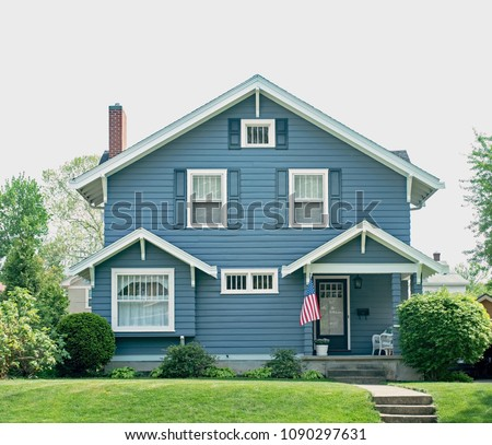 Basic Blue House with Small Porch & White Trim