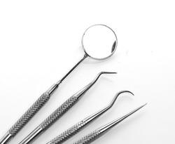 Basic dentist tools isolated on white