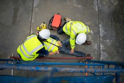 Basic first aid training for support accident in site work, Builder accident fall scaffolding to the floor, Safety team help employee accident.