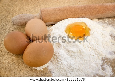 Basic ingredients for baking, egg and flour on table