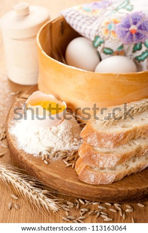 Basic ingredients for baking, white bread and wheat ears