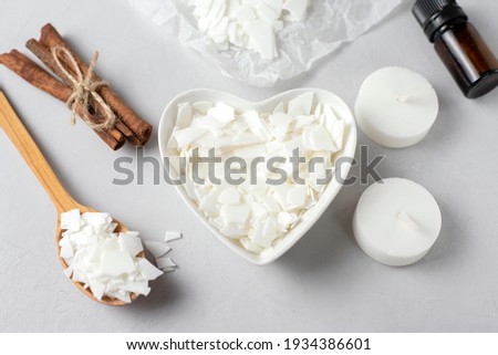Basic set for home-made natural white eco soy wax candles in glass, wick, perfume. Idea for a hobby, business. Making trendy diy candles without harm to health on white background.