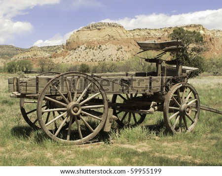 Basic transportation in the Old West: wooden wagon on grassy valley floor in New Mexico